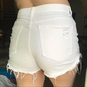 White high waisted distressed demon shorts
